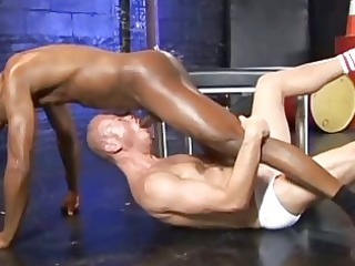 shaved lad is engulfing large darksome rod in