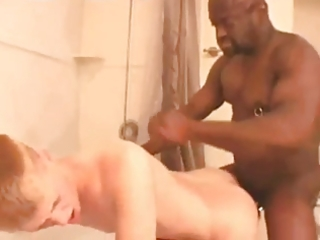 large dark dad creams golden-haired in shower