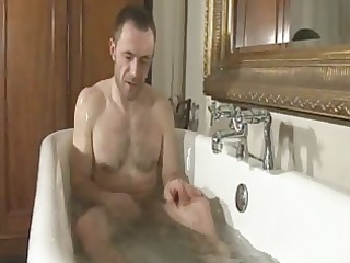 a chap is jerking off when taking a bathroom