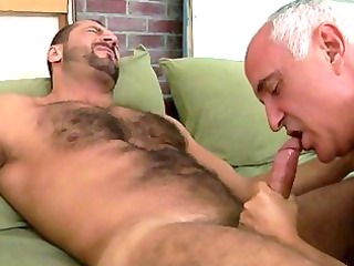 an old guy is engulfing his fellas ramrod