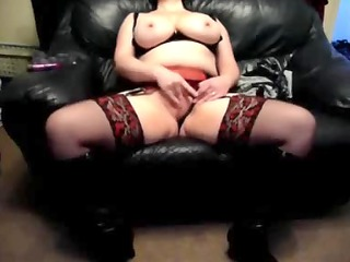 excited wife on a leather sofa at home