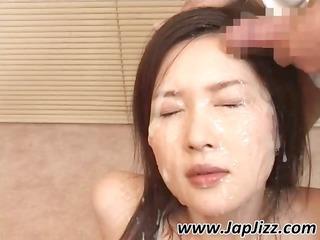 Asian girl gets a bunch of cocks going off on her