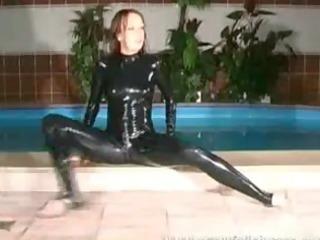 cute hottie in rubber suit widening her legs in