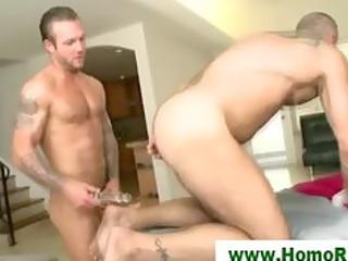 hunk shoves sex-toy up masseurs butt