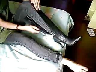 milla putting her dark leather boots