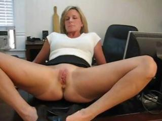 older blond secretary widens her legs and