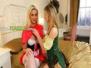 agreeable beauties teasing jointly on sofa