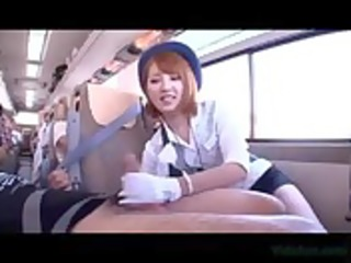 oriental bus attendant giving oral for passenger