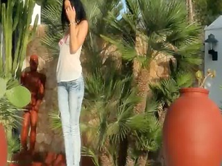 blackhaired model teasing exposed outdoors
