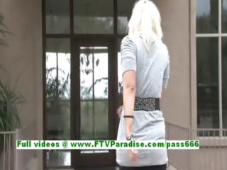 vicki sexy blond woman fingering muff on a chair