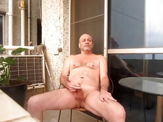 stroking undressed on balcony
