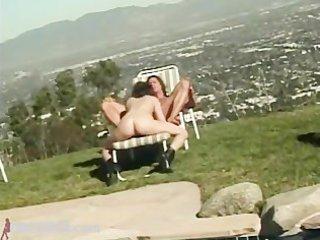 juvenile bitch takes a weenie pool side