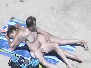 sexually excited wife with large tits on beach