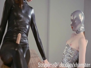 domina in shiny catsuit gives weenie