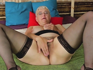 nasty aged whore teasing herself with her toy