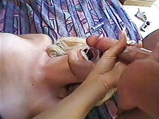 golden-haired receives a facial from a large wang