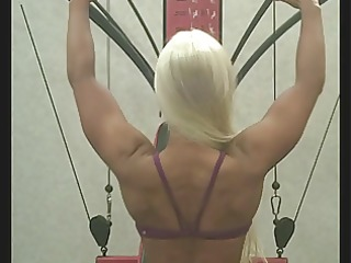 hot golden-haired works out at the gym
