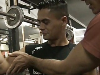 muscled fellows having sex in a gym