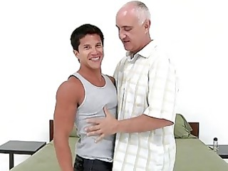 youthful tanned homo lad bangs with mature