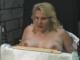 candy receives restrained on a chair with leather