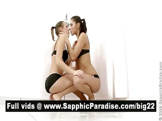 angelic brunette hair lesbos giving a kiss and
